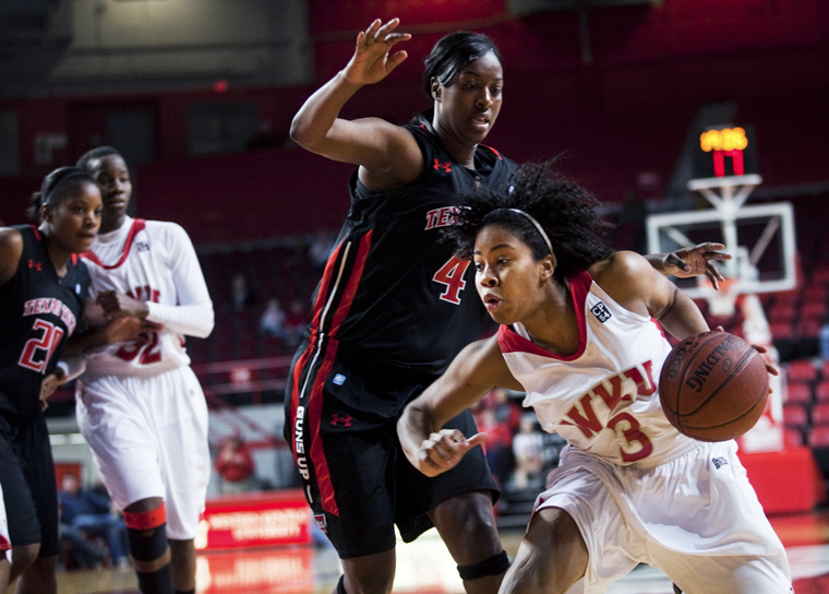 Senior+guard+Amy+McNear+drives+toward+the+basket+during+the+Lady+Toppers%E2%80%99+game+against+Texas+Tech+on+Dec.+29.+WKU+is+6-4+in+Diddle+Arena+this+season+but+2-7+on+the+road.