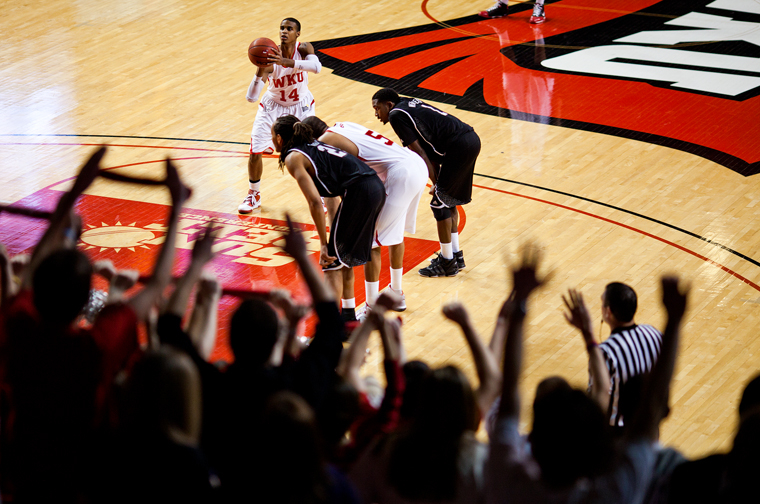 Sophomore+guard+Jamal+Crook+shoots+free+throws+while+WKU%27s+student+section+cheers+him+on+in+the+first+half+of+their+home+game+Saturday+against+Troy.++Crook+played+for+20+minutes+and+recorded+eight+points%2C+nine+assists+and+eight+rebounds.+WKU+won+77-58.