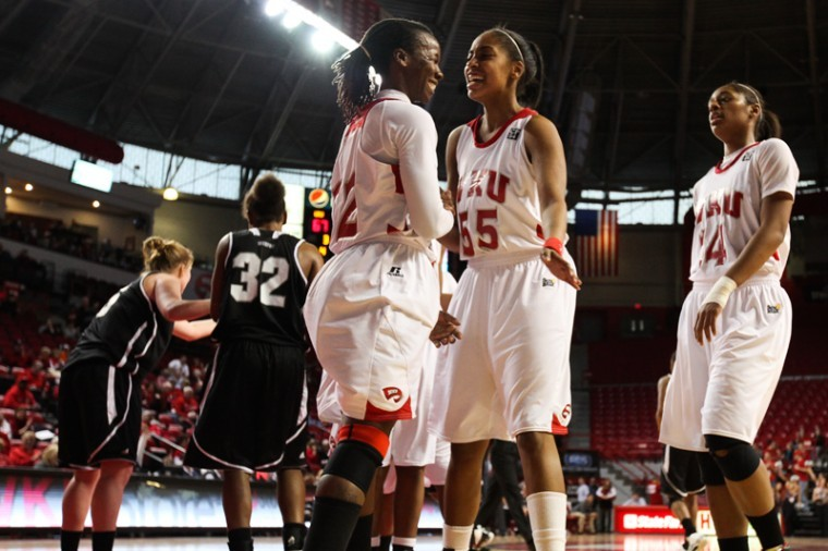 Arnika+Brown+and+Jasmine+Johnson+celebrate+a+basket+scored+by+Brown+during+Saturdays+game+against+Troy.+The+Lady+Toppers+won+the+game%2C+92-76.