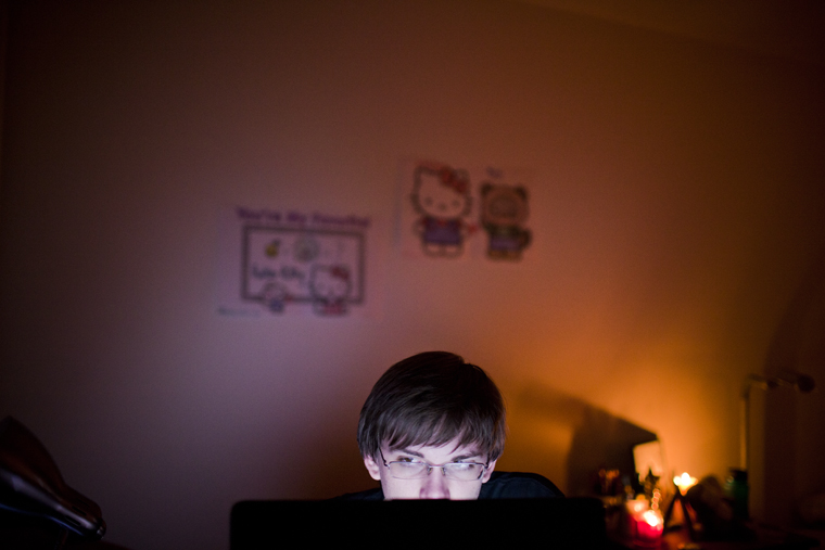 Monticello junior Ben Hutchison listens to music on his laptop in his apartment in the early morning on Tuesday before a long day of classes. Hutchinson, who rarely sleeps because of insomnia, often hangs out with friends and studies with the extra time that he spends awake.
