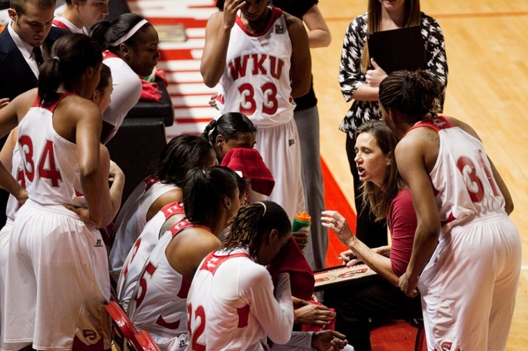 Mary Taylor Cowles talks to the Lady Toppers during a timeout in WKU's 51-50 loss to Denver Wednesday. Cowles said the Lady Toppers have to move on from the loss before Saturday's game against North Texas.