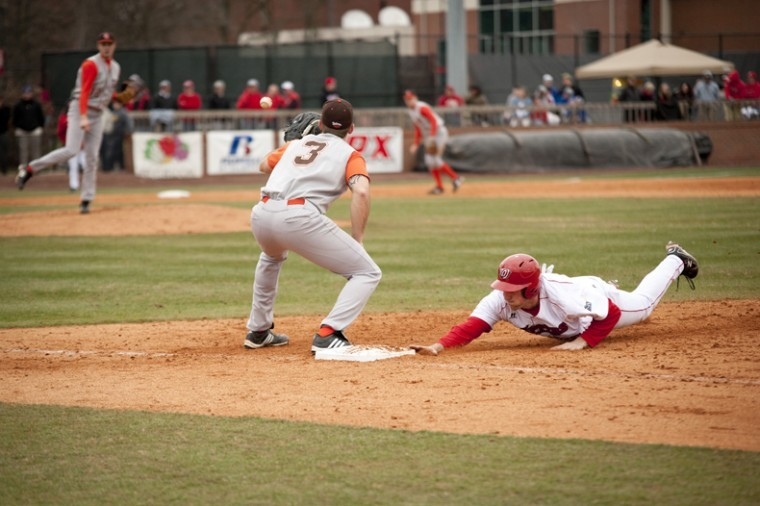 Senior+outfielder+Matt+Bracken+narrowly+gets+to+first+base+before+BGSU+pitcher+Cody+Apthorpe+throws+to+Clay+Duncan+during+the+fifth+inning+of+WKU%27s+game+against+the+Falcons+Saturday+at+Nick+Denes+Field.+WKU+won%2C+8-7.