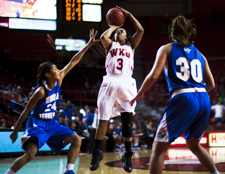 Senior+guard+Amy+McNear+makes+a+jump+shot+during+Wednesday+night%27s+sparsely-attended+game+against+Middle+Tennessee.+WKU+lost+the+game%2C+72-66.