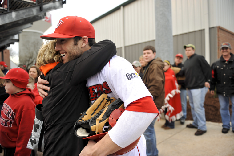 Junior outfielder Kes Carter embraces a fan after the game against Bowling Green State on Saturday at Nick Denes Field.  WKU won 8-7.  DANNY GUY/Herald