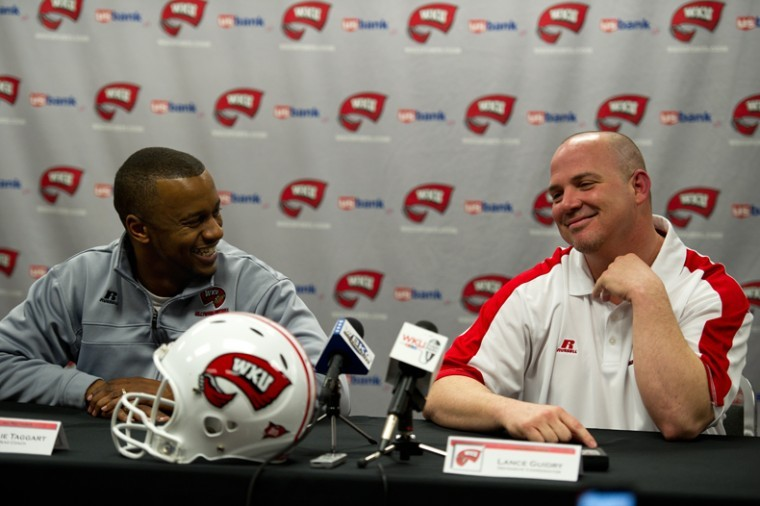 WKU+Head+coach+Willie+Taggart+%28left%29+and+new+defensive+coordinator+Lance+Guidry+discuss+the+past+and+the+future+of+WKU+football+in+a+press+conference+Friday.+The+announcement+officially+introduced+Guidry+as+the+Toppers+new+DC.