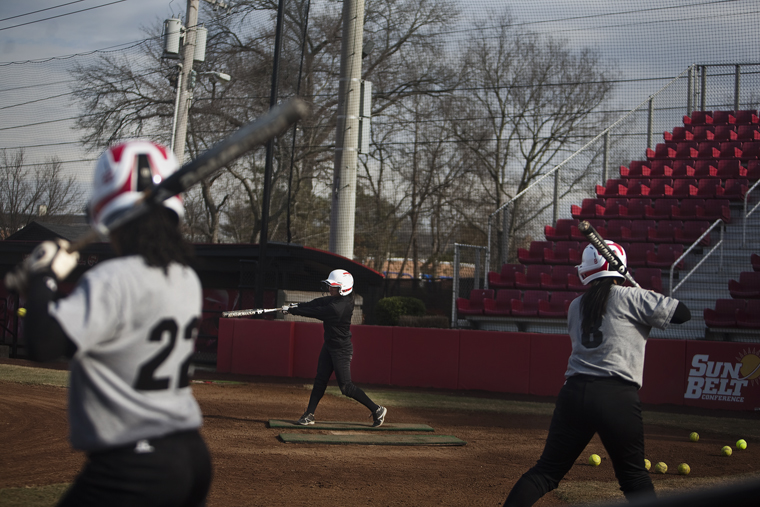 The Lady Toppers softball team warms up with offensive practices before they begin their scrimmage at the WKU Softball Complex on Friday.