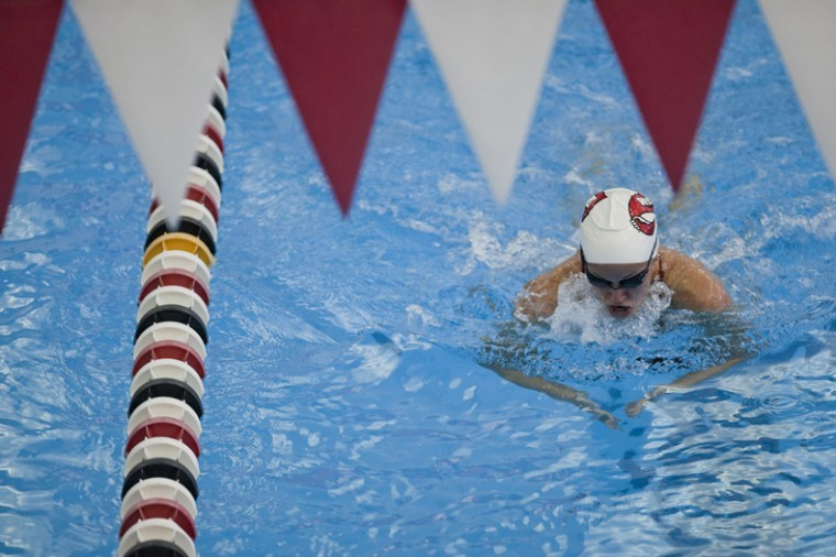 Senior+Brittany+Doss+gasps+for+air+as+she+swims+the+100-yard+breaststroke%2C+the+ninth+of+32+swimming+events+at+the+meet+against+SIU+in+the+Bill+Powell+Natatorium+on+Saturday.+Doss+came+in+first+in+the+event+with+a+time+of+1.05.24.+