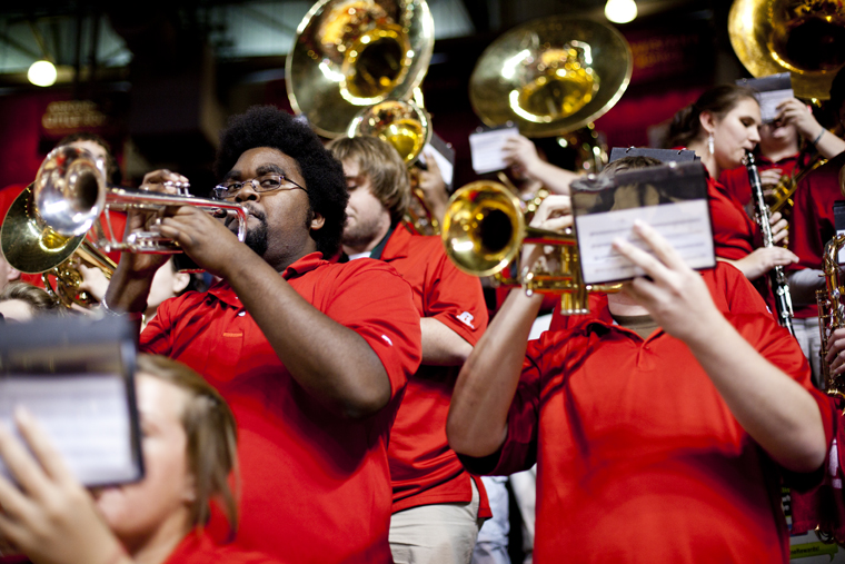"""""""Super trumpet"""" player Kevin Goodnight, a senior from Bowling Green, performs in the pep band at a men's basketball game in Diddle Arena. Goodnight is known for sneaking into the stands among fans with his trumpet and playing a distinctive solo to the song """"Vehicle"""" by The Ides of March late in the second half of WKU home games."""