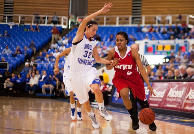 Senior+Amy+McNear+drives+towards+the+basket+during+the+first+half+of+Sundays+game+at+MTSU.+The+Lady+Toppers+lost%2C+64-56.