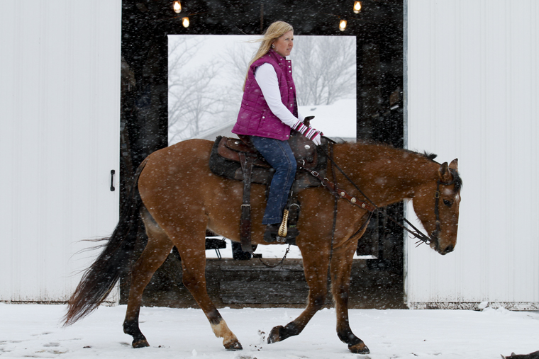 """Debbie Dismon, an office associate for Parking and Transportation Services, prepares a quarter horse named """"Little Bit"""" for riding on Monday afternoon. Dismon took Basic Horse Equitation in fall 2009 as part of a program that lets WKU employees take classes for free."""