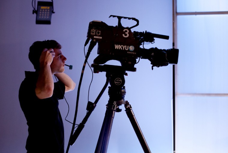 Benton+junior+Austin+Anderson+prepares+the+set+at+WKYU-PBS+before+the+filming+of+%E2%80%9COutlook%E2%80%9D+on+Wednesday.+Several+WKU+students+work+at+the+television+station%2C+which+could+have+its+funding+cut+if+the+U.S.+Senate+passes+a+bill+next+week+that+would+eliminate+federal+funding+of+public+broadcasting.