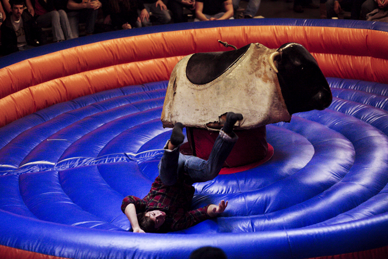 Tyler Wittmer, a Phi Gamma Delta fraternity member, is thrown from the mechanical bull after a ride in the semifinal round during an event hosted by Sigma Phi Epsilon fraternity at the Blue Dome on Friday.