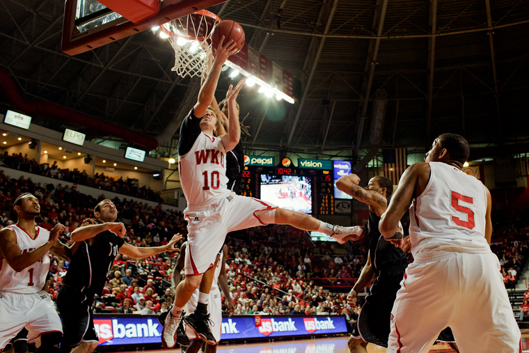 Sophomore+guard+Caden+Dickerson+fights+Troy%27s+defense+for+a+layup+in+the+first+half+of+their+game+against+Troy+in+Diddle+Arena.++WKU+won+77-58.