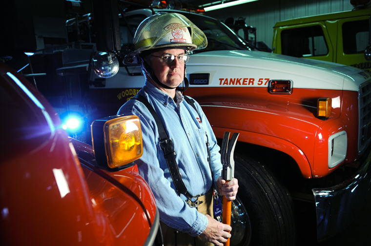 """Woodburn resident Bob Skipper, 50, balances two jobs: volunteer fire chief for the Woodburn Fire Department and director of WKU Media Relations.  Skipper has been fire chief for about six years, but he has been a volunteer firefighter for almost 25. He also has worked at WKU for 24 years.  """"I've been very fortunate in that my supervisors understand what I do,"""" Skipper said, who averages four meetings a month along with training for the fire department.  """"I enjoy helping people,"""" Skipper said.  """"We've got a great community, and we're fortunate that they are very supportive of the department."""""""