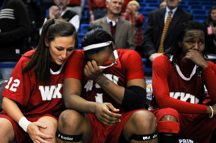 Keisha Mosely is comforted after by teammate Chaney Means after WKUs loss to Arkansas-Little Rock. The Lady Toppers lost the Sun Belt championship game, 66-59.