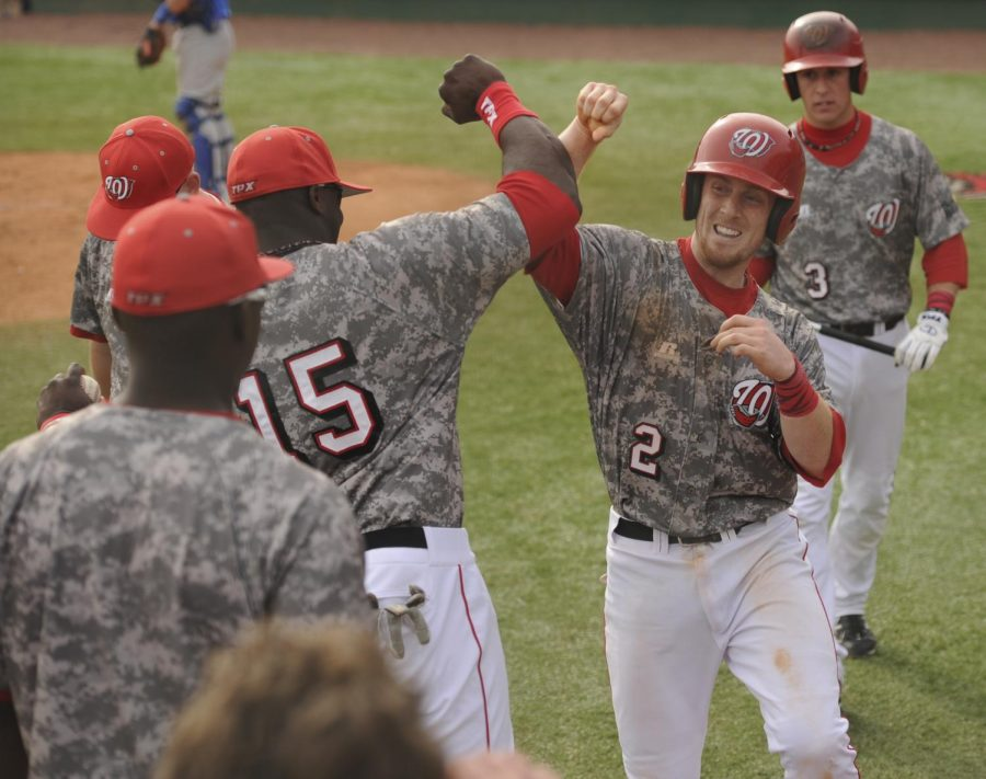 WKU's Ivan Hartle celebrates with his teammate Chris Bullard after scoring a run in Saturday's game against Middle Tennessee. The Toppers host Austin Peay at 6 p.m. Tuesday.