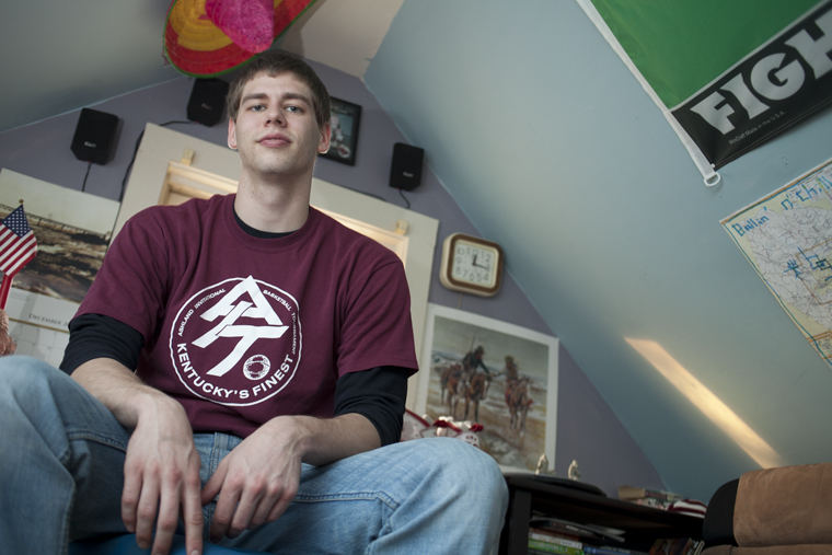 Ryan Stone/HERALD Louisvile senior Blake Blackburn lives in a small A-frame attic room on Center Street. At 6 foot 5 inches, Blackburn's head almost touches the ceiling of the 6-foot-6-inch room.