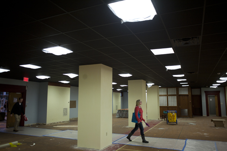A WKU student walks through the future Chinese Learning Center being built on the first floor of Helm Library on Monday.