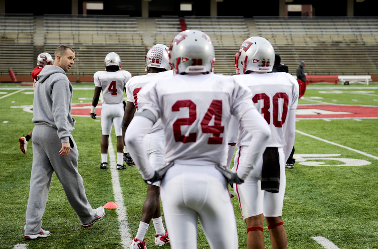 New WKU offensive coordinator Zach Azzanni talks to players before running drills during WKU's spring football practice last Friday afternoon at Houchens-Smith Stadium.