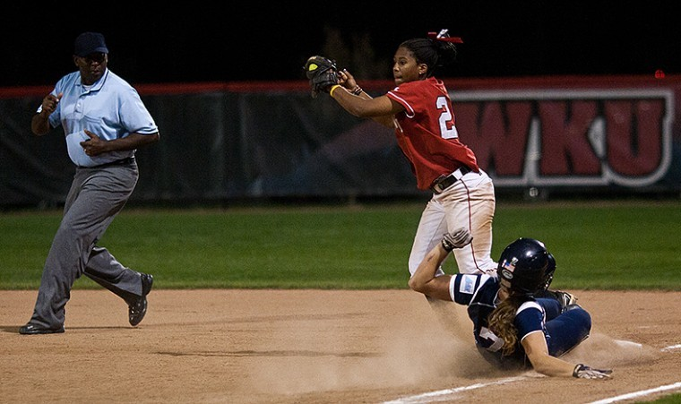 WKU+freshman+infielder+Kelsie+Mattox+catches+the+ball+for+the+out+as+Belmont%27s+senior+pitcher+Julie+Harmon+slides+into+first+base+during+the+second+game+of+the+doubleheader.+The+Lady+Tops+won+the+second+game%2C+9-1.