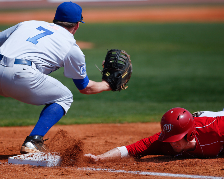 Ivan+Hartle+slides+into+first+base+during+a+pick-off+play+during+Sunday%27s+game+against+Middle+Tennessee.+The+Toppers+beat+MTSU+5-4%2C+sweeping+the+weekend+series.