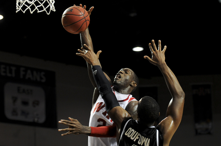 Juan+Pattillo+is+fouled+on+a+shot+against+George+Odufuwa+of+North+Texas.+WKU+lost+the+game%2C+81-62%2C+and+was+eliminated+from+the+Sun+Belt+tournament.