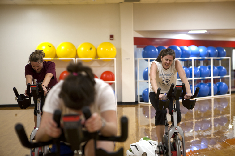 """Florence graduate student Katelyn Fichner pushes through the end of the 4 p.m. to 4:50 p.m. spinning class at the Preston Center on Monday afternoon.  """"I'm just working out to get in shape,"""" Fichner said."""