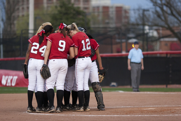 The Lady Topper softball team huddles at the pitchers mound during the first game of its successful doubleheader against Belmont on Tuesday in Bowling Green.