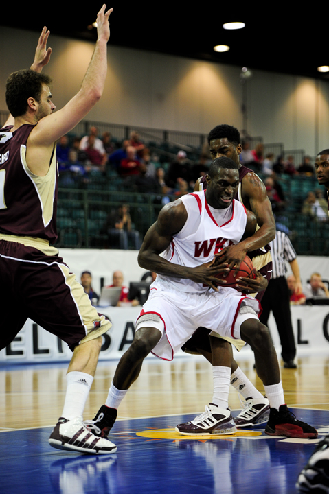 Senior forward Juan Pattillo fights for the ball against Louisiana-Monroe defenders. The Toppers won and will play Louisiana-Lafayette on Sunday in the Sun Belt tournament.