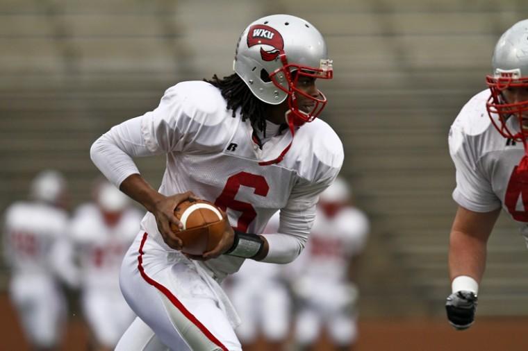 Junior+quarterback+Kawaun+Jakes+runs+a+play+during+spring+practice+drills+on+Friday+afternoon+at+Houchens-Smith+Stadium.+Jakes+enters+spring+ball+as+WKU%27s+No.+1+quarterback.