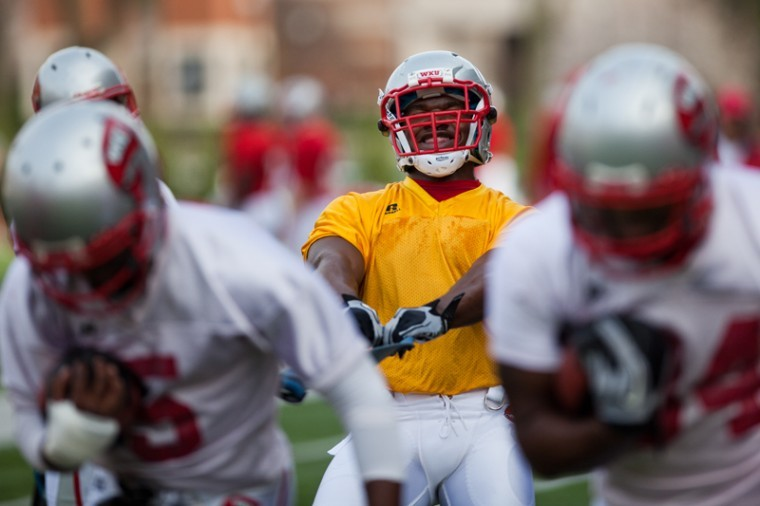 Jnuior+running+back+Bobby+Rainey+%28yellow%29+runs+drills+with+his+teammates+during+the+team%27s+spring+practice+on+Monday+afternoon.+Rainey+wears+a+yellow+jersey+to+denote+that+he+cannot+be+tackled.