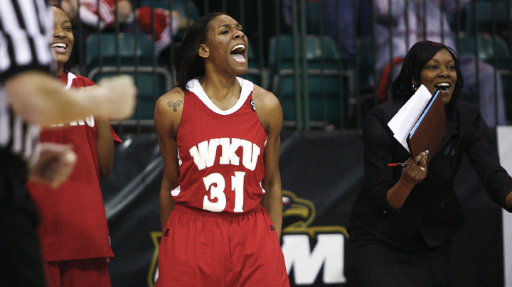 Junior LaTeira Owens celebrates courtside after the Lady Toppers score in the second half of Sundays game against Denver. WKU won 65-57 and advanced to the semifinals of the Sun Belt tournament.