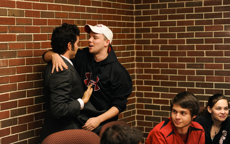 Diego Leal Ambriz, far left, senior from Monterrey, Mexico, congratulates his competitor, Hawesville junior Billy Stephens, just after midnight Thursday morning in the DLI room of DUC. Stephens beat Leal Ambriz, 597 votes to 469. Im just really pumped, said Stephens.