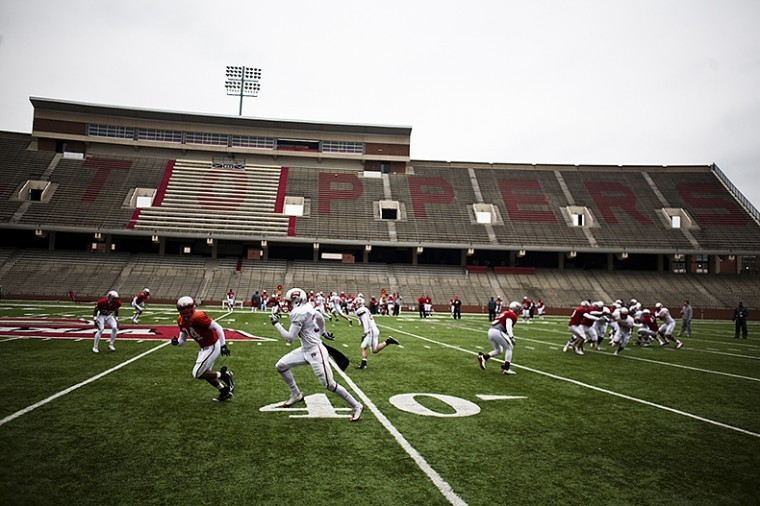 WKU football players run a play at a practice last Wednesday. The Toppers held their first scrimmage Saturday, running through situational plays.