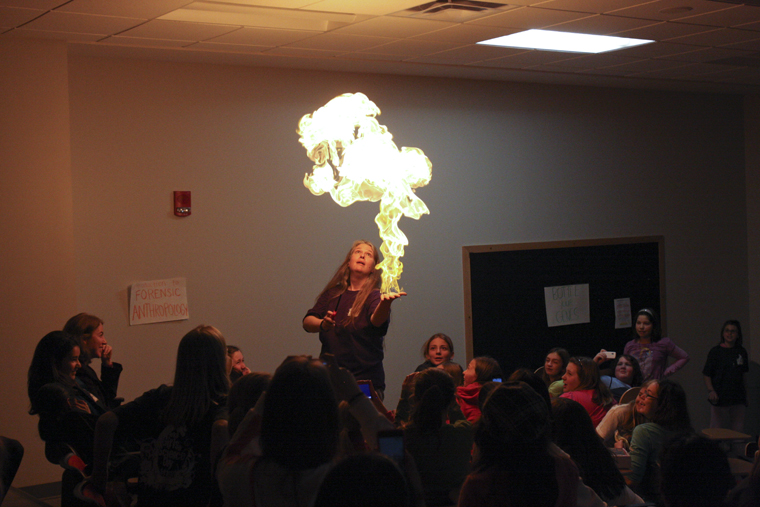 """Alicia McDaniel of the chemistry department performs a chemistry magic show for about 187 girls and parents on Saturday in Snell Hall for WKU's annual Girls in Science Day. """"I ask myself who has more fun, me or the girls. And I think it's me,"""" McDaniel said after the show."""