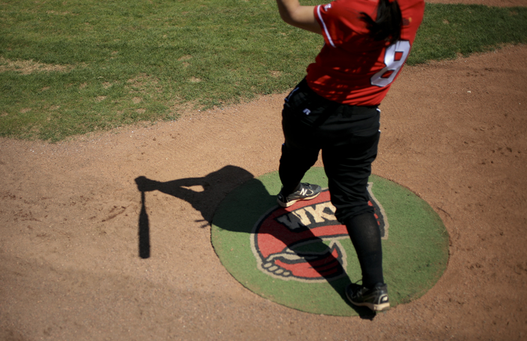 WKU freshman Megan Johnson warms up in the on-deck circle before her turn at bat during Sunday afternoon's game against North Texas. WKU lost 11-7 but won the first two games of the series.