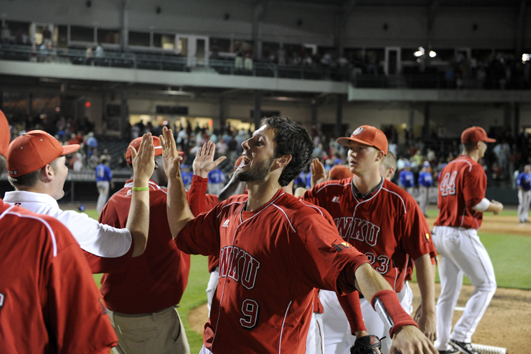 Senior+catcher+Matt+Rice+congratulates+teammates+after+WKU%E2%80%99s+11-8+victory+over+Kentucky+Tuesday+evening+at+Bowling+Green+Ballpark.+Rice+broke+WKU%E2%80%99s+all-time+hit+record+with+his+282nd+career+hit+Tuesday+night.+Rice+had+four+hits+in+the+game%2C+giving+him+285+in+his+career.