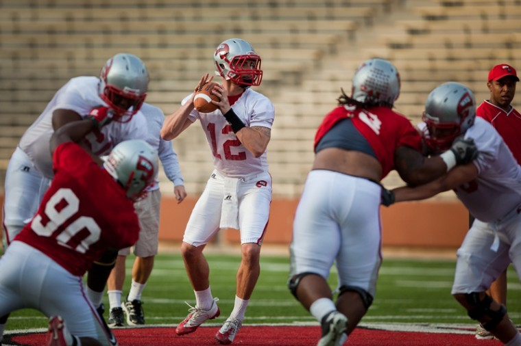Freshman quarterback Brandon Doughty looks for a receiver to throw to during WKU's first spring practice. Head Coach Willie Taggart said Doughty and junior Kawaun Jakes have created strong competition at quarterback throughout the spring.
