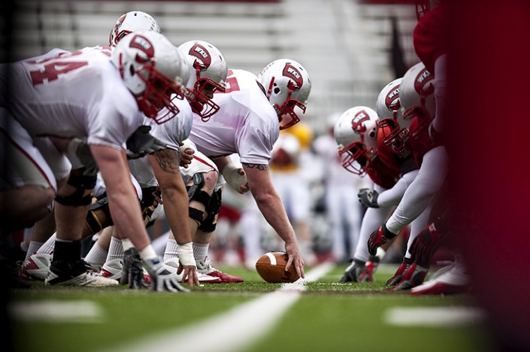 WKU+football+players+line+up+for+a+play+during+practice+at+Houchens-Smith+Stadium+earlier+this+spring.+The+Toppers+will+host+their+annual+spring+game+Saturday+at+5+p.m.