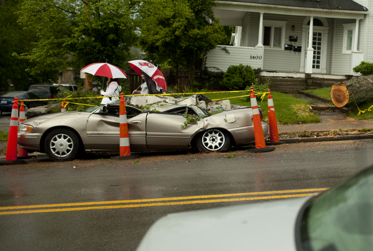 """Owensboro graduate student Eric Vanover's car sits on the Hill on College Street. The car was smashed by a tree from the storms that swept through Bowling Green this week.  """"It's demolished,"""" Vanover said.  """"It was mine for a total of two days.""""  His previous car was totaled in an accident days before."""