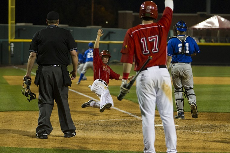 WKU+second+baseman+Ivan+Hartle+slides+into+home+plate+during+the+game+against+UK+at+Bowling+Green+Ballpark.+The+Toppers+won+11-8+in+front+of+5%2C142+fans.