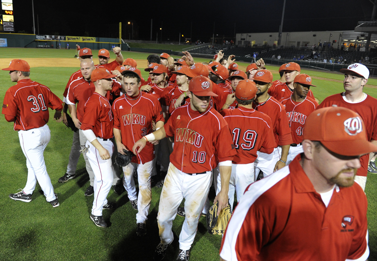 The+Toppers+break+from+a+postgame+huddle+after+defeating+Kentucky+11-8+last+Tuesday+at+the+Bowling+Green+Ballpark.+WKU+was+swept+at+Troy+over+the+weekend+but+returns+home+to+host+No.+2+Vanderbilt+tonight+at+6+p.m.+at+Nick+Denes+Field.