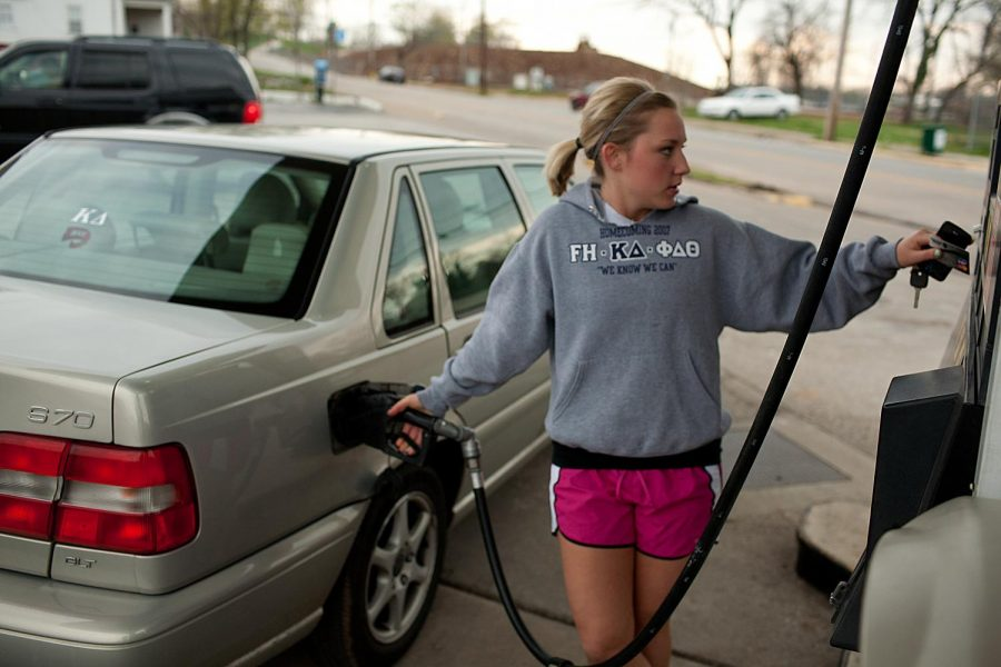 """London senior Haley Schenkenfelder pays for gas at Junior's gas station on Thursday afternoon. Schenkenfelder pays about $40 a week for gas. """"Even though my parents help pay for gas, I could use the extra money for food,"""" she said."""