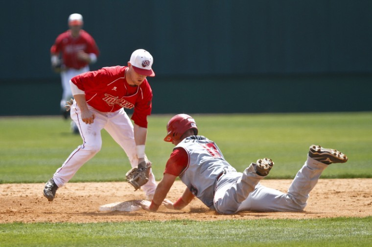 WKU junior infielder Ivan Hartle tags Chris Sinclair out during the Toppers' game against Louisiana-Lafayette at Nick Denes Field on Sunday afternoon. WKU lost 8-6, but won the series.