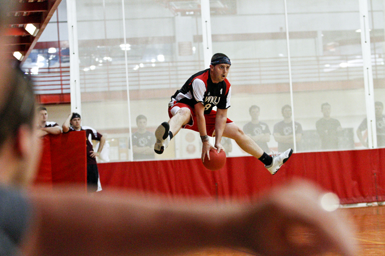 Andrew+Swanson+jumps+to+dodge+a+ball+during+WKU%E2%80%99s+third+game+against+Saginaw+Valley+State+University+on+Saturday+afternoon+at+the+2011+National+College+Dodgeball+Association+tournament+at+the+Preston+Center.+WKU+lost+2-1.