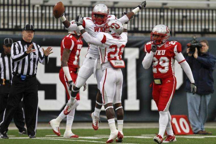White team wide receiver Rico Brown and running back Avery Habbitt celebrate after scoring Saturday afternoon at the Red and White spring game in Houchens-Stadium. White team won 27-11.