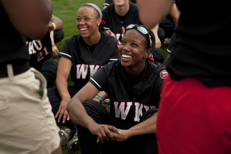 Senior outfielder Brittney Perry laughs with teammates in the outfield after WKUs 7-6 victory against Louisiana-Monroe on Saturday afternoon. The Lady Toppers swept the weekend series against ULM.