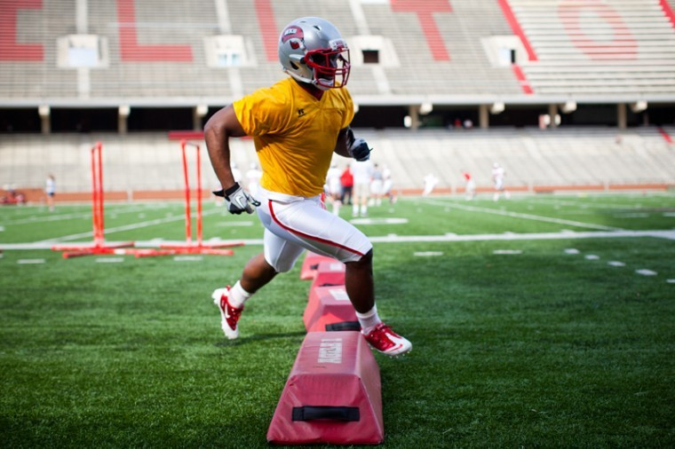 Senior running back Bobby Rainey runs drills during a WKU practice earlier this spring. Rainey participated in Saturday's scrimmage, rushing for 103 yards and two touchdowns.