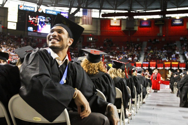Graduate Sergio Kerusch, a former men's basketball player, smiles during WKU's 169th Commencement Ceremony Saturday afternoon in Diddle Arena.