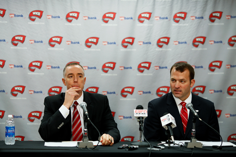 Men%27s+basketball+Head+Coach+Ken+McDonald%2C+left%2C+listens+Monday+as+Athletics+Director+Ross+Bjork+announces+the+university%27s+decision+to+keep+McDonald+as+head+coach+after+a+tumultuous+16-16+season.